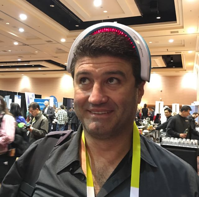 Stephen Fenech tries out a laser hair treatment gadget at CES Unveiled