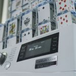 Watch a record-breaking house of cards being built on a running LG washing machine