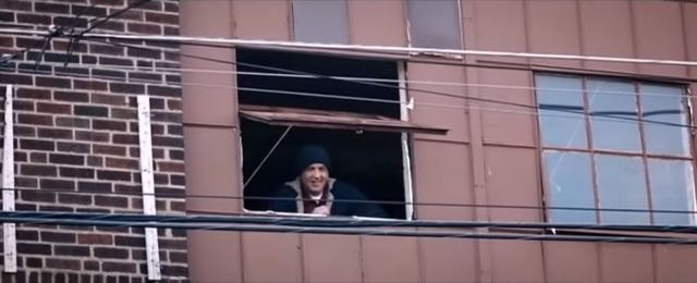Rocky peeks out of the first window above the roller door in Creed