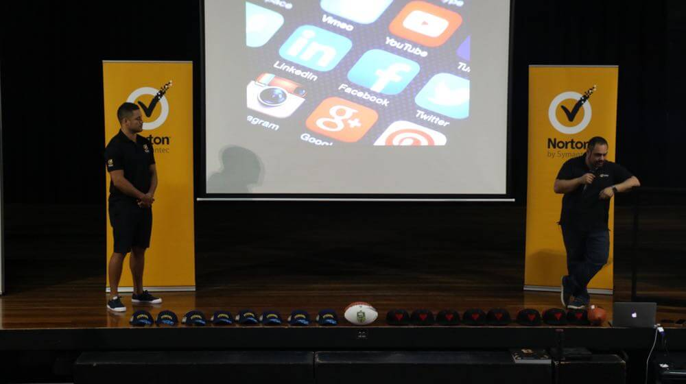 Jarryd Hayne and Norton's Nick Savvides during the cyber safety session at Robina State High School