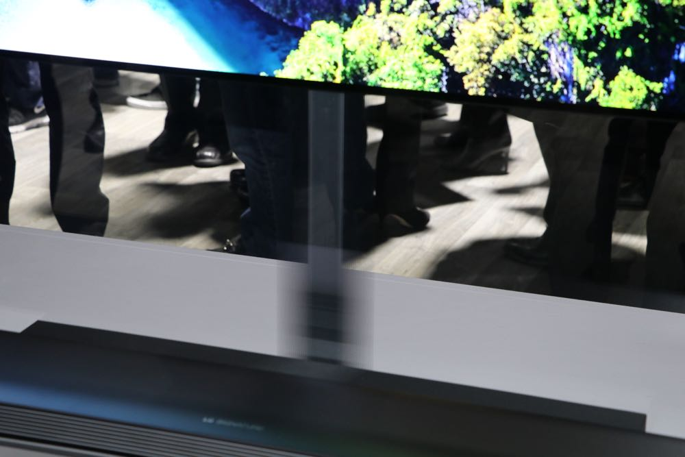 The LG Signature OLED W screen is connected to the soundbar with a nearly invisible ribbon cable