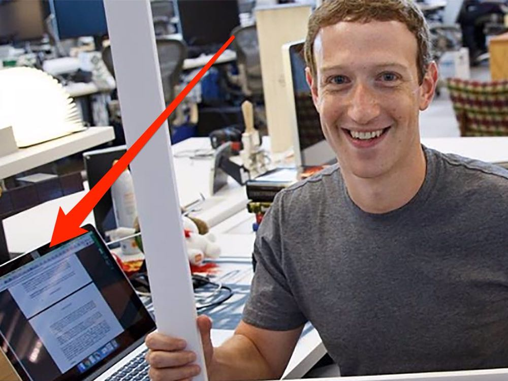 Facebook founder Mark Zuckerberg covers his laptop camera with duct tape