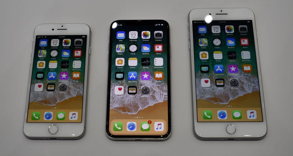 The iPhone X (centre) and between the new iPhone 8 and iPhone 8 Plus