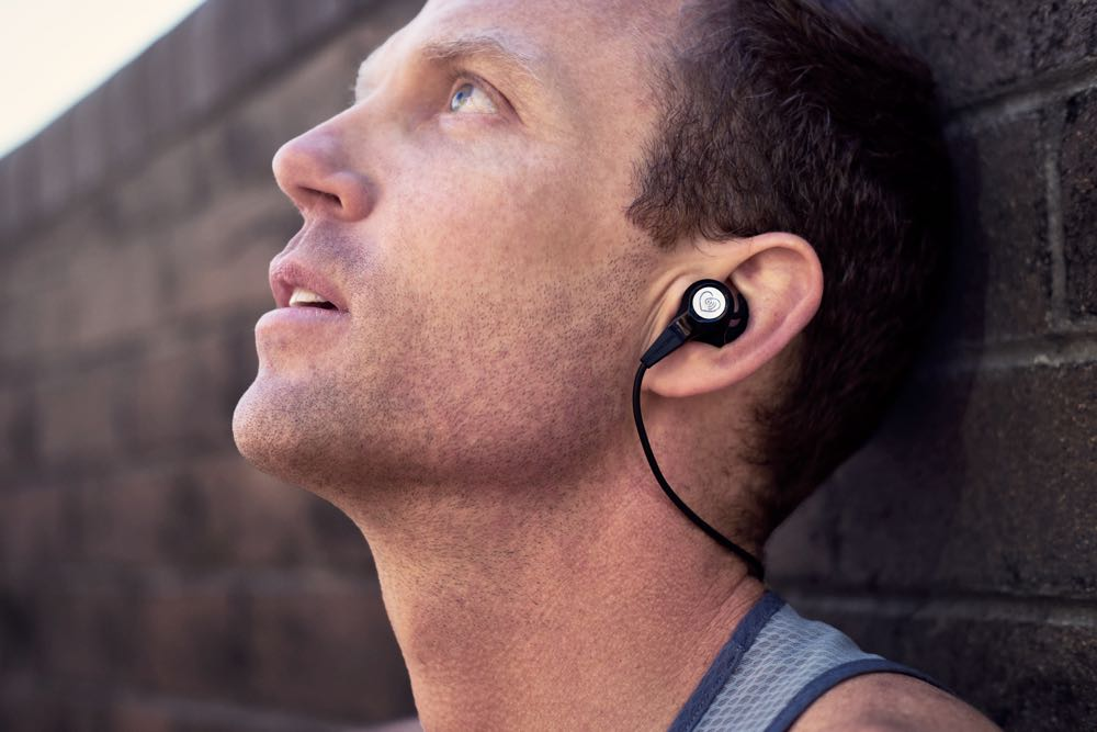 Australian 5000m and 10000m Olympian Ben St Lawrence wears the new BioConnected HR+ biosensing ear phones