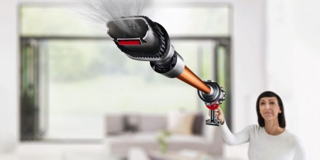 arm holding product towards camera, high camera angle, combination tool in large scale, showing its power as fine dirt particles and dust are being sucked up.