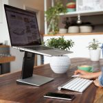 Tiny Tower puts your laptop at a comfortable height to save your neck